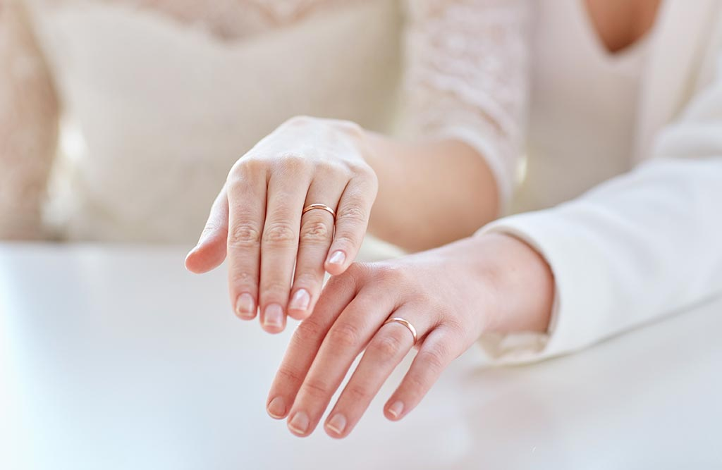 Brides showing off their wedding rings