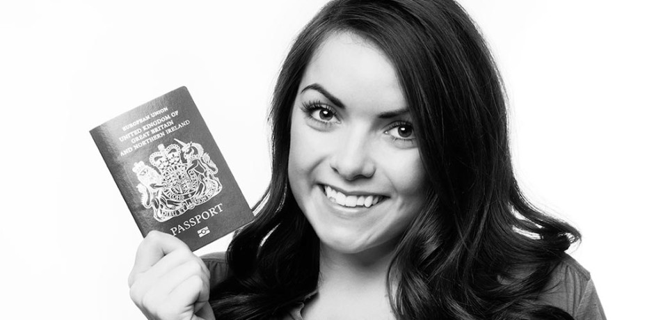 Woman holding up British passport