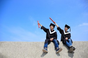 Graduates showing off their qualifications