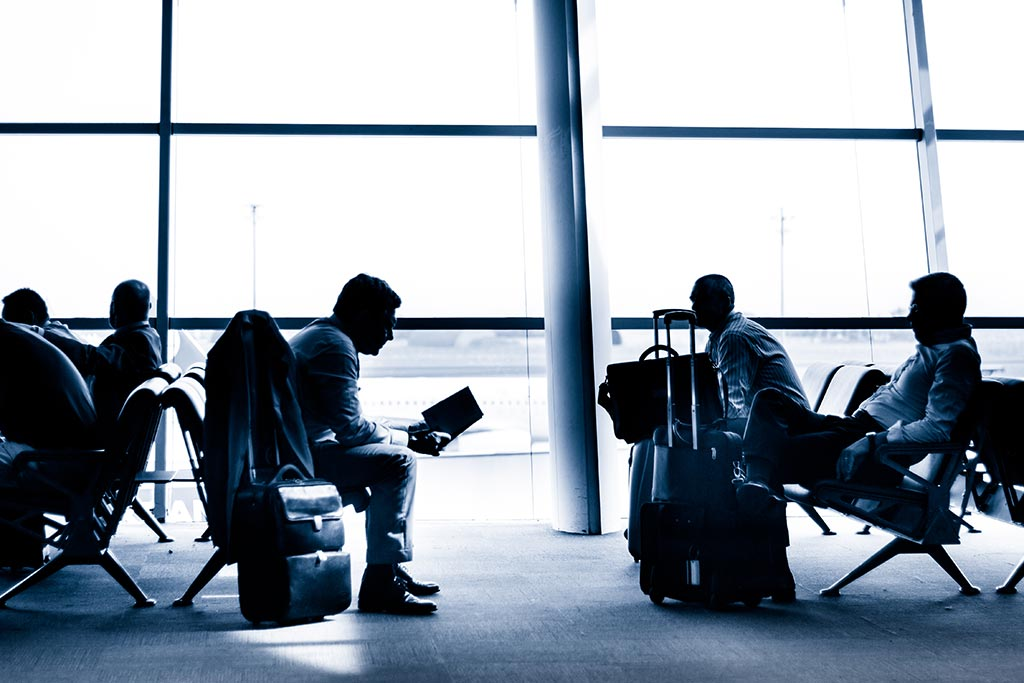 Business Commuters waiting in airline lounge