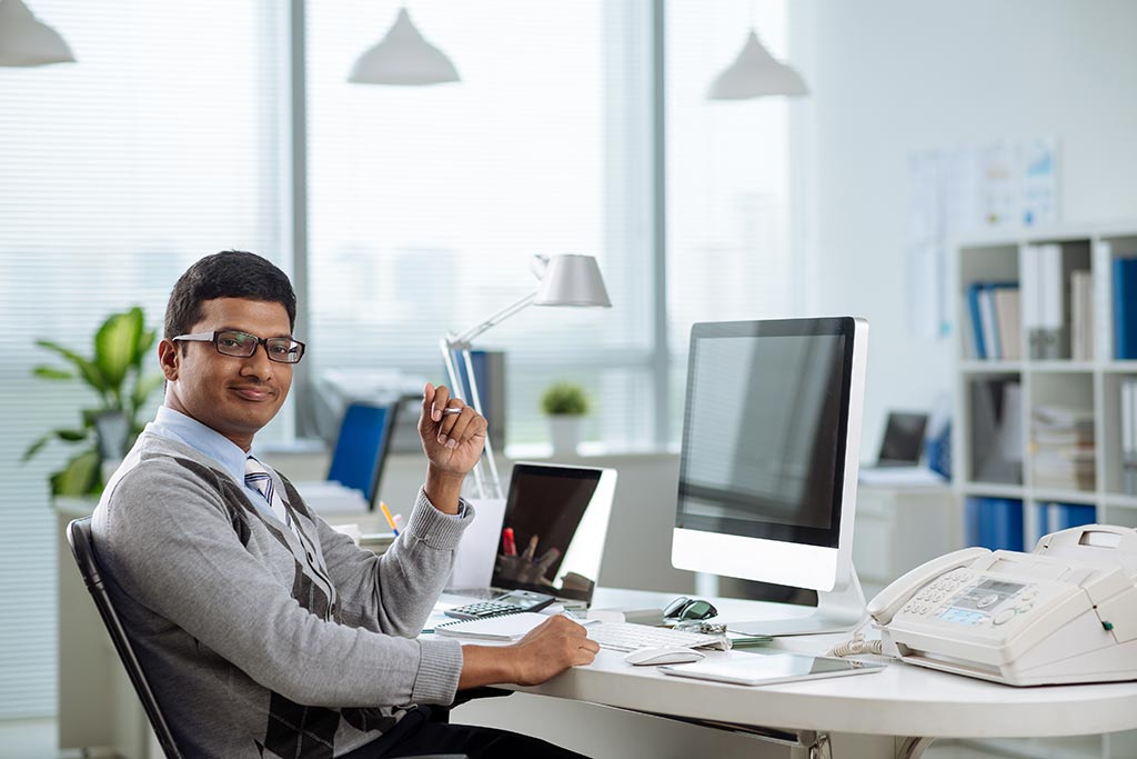 Happy entrepreneur/businessman in his office